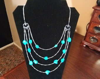 Turquoise trade beads with silver.