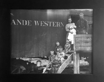 Old Western family photo. Living in a train car.
