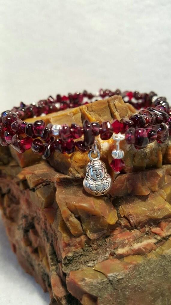 Garnet,swarovski crystal, silver plate beads and smiling buddha charm memory bracelet