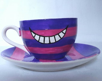 Hand Painted Cheshire Cat tea cup (175ml)  and saucer (14.5cm), inspired by Disney Alice in Wonderland