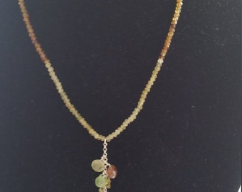 a most elegant grossurar garnet necklace .In the middle there is a sterling siler chain eith grossurar briolettes hanging