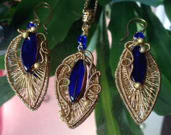 Unique earrings and pendant wire  wrapped in  brass