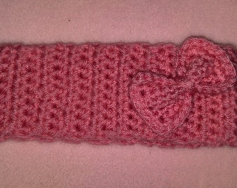 Crochet pink infant headband with bow