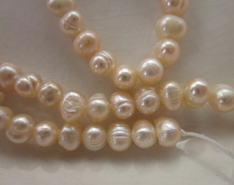 "Pale Peach Freshwater Pearls, A Quality, 6.5mm Potato, 14.5"" Strand"