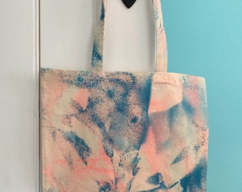 Pink and blue spray paint tote bag