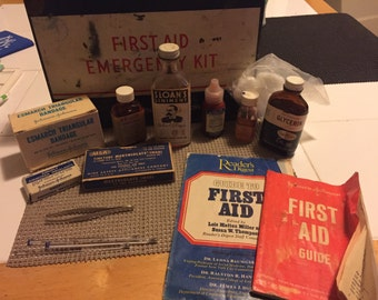 Vintage first aid kit with supplies