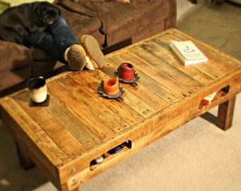 Rustic coffee table.  reclaimed pallet wood.  hand crafted.  oak. shelves. storage.