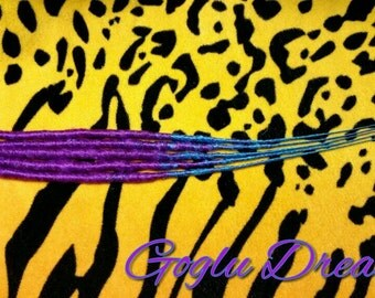 5 accent wrapped dreads in purple and turquoise.