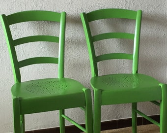 Two lovely green mellow old chairs