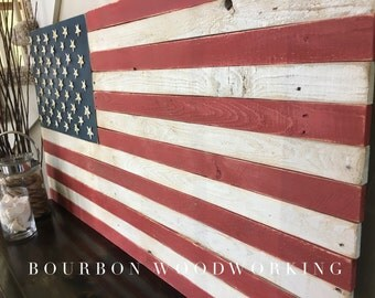 """American Flag made of reclaimed wood. Hand painted and distressed.  Starfish as stars. ~49""""x26"""""""