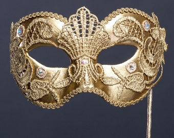 Venetian mask. Masquerade mask.  Carnival gold masks. Lace mask on stick