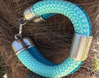Blue braided rope and silver bracelet