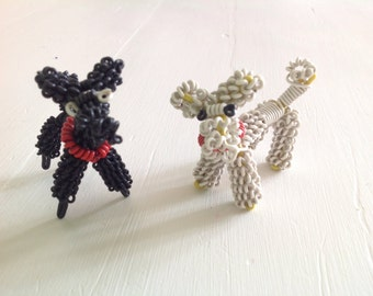 Very unique miniature wire poodles dogs in black and white from the 1950s midcentury