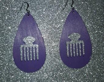 Wood Afro pick earrings.