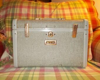 Vintage suitcase train case