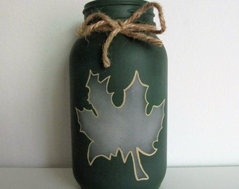 Hand-painted Mason Jar Candleholder featuring an Autumn Leaf and a Twine Bow