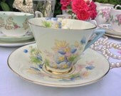 Art Deco English Bone China: Royal Doulton tea cup and Saucer small chip in top rim, cabinet piece