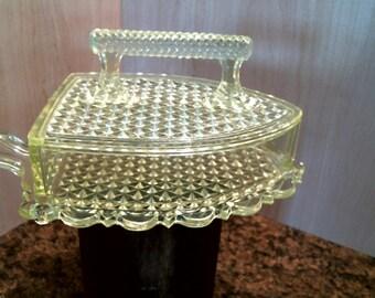 Vaseline glass iron shape covered dish.