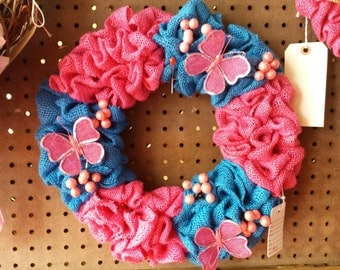 Pink and blue burlap spring wreath with bitterlies