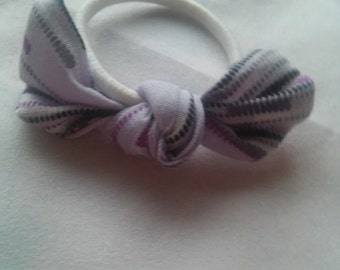 Purple digi hair tie, ponytail holder, knotted fabric.