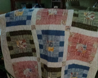 Blooming spring lap quilt with current fabric and butterfly quilting detail.