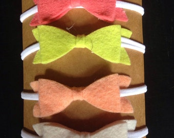Four Nylon Headbands With Bows