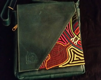 Leather handbag and stiched fabric design