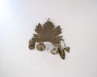 Tribal maple leaf pendant with charms