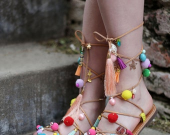 gladiator leather sandals with pompoms