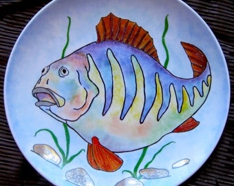 Decorative fish, a plate on the wall, hand-painted.