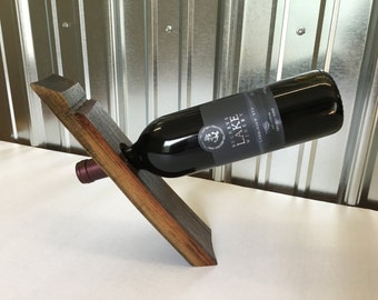 Floating wine bottle holder made of oak barrel stave