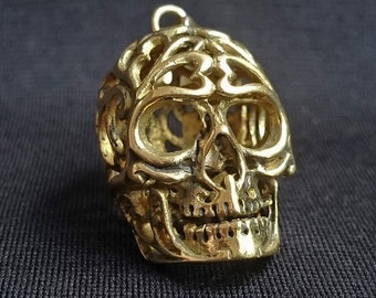 Small pendant carved brass