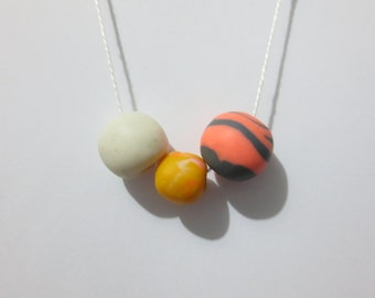 tangerine - white - dark grey - coral