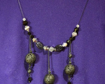 Dramatic black, silver and sparkly dark purple necklace