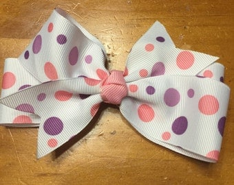 Pink purple and white polka dotted hair bow