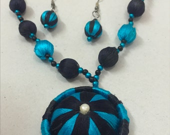 Blue necklace with white pearl pendant