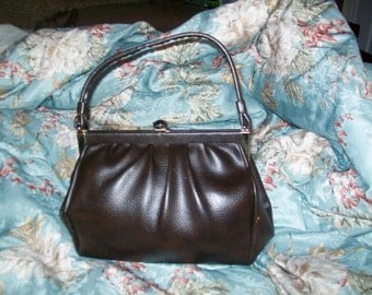 Vintage Kelly style brown vinyl handbag purse from the 60's