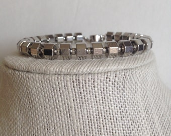 Silver metal nut bracelet with alternating silver tone beads featuring a magnetic clasp
