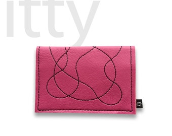 The wallet called itty (shown in BARBIE PINK)