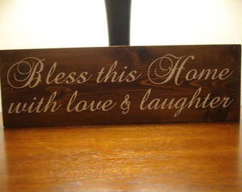 Bless this Home with love and laughter wood sign