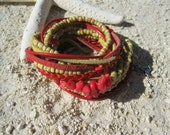 Boho Leather Wrap Bracelet and Necklace, Multi Strands of Leather and beads in shades of reds, creams and mixed with red coral