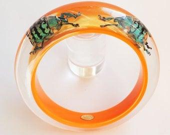 Fun bright orange lucite bracelet with real exotic beetles