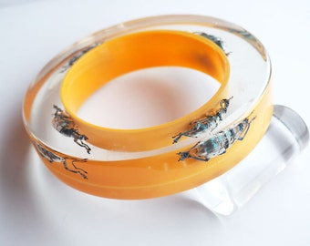 Huge yellow lucite bracelet with real iridescent beetles