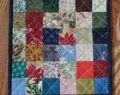 Scrap mug rug. Candle mat. Small quilt. Mini quilt. Scrappy tablemat.