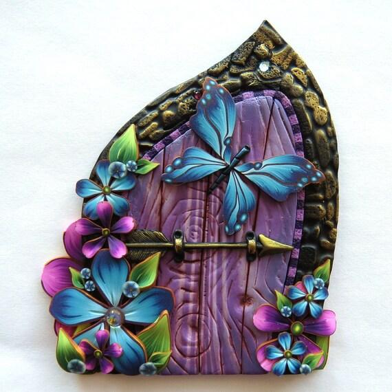 Purple fairy door with a blue butterfly for Purple fairy door