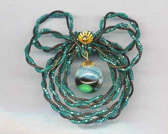 Vintage Holiday Wreath . Twisted Green & Bronze Beadwork . OOAK Green Wreath with Marbled Glass Globe - Christmas by enchantedbeads on Etsy