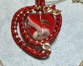 Reversible red swirl heart pendant
