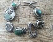 Sterling silver, handmade, treasure bracelet.  Amethyst, tuquoise, malachite, labradorite....