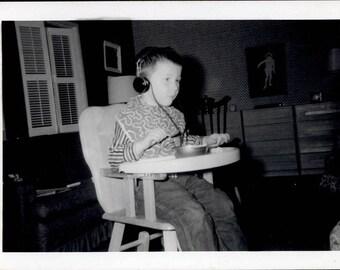 vintage photo unusual 1958 Boy Headphones Listens Intently Highchair Strange Look medical Snapshot
