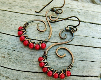 Hammered Copper Swirls with Red Coral beads criss cross wire wrapped in antiqued copper dangle earrings